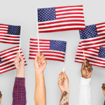 Hands Raising US Flags