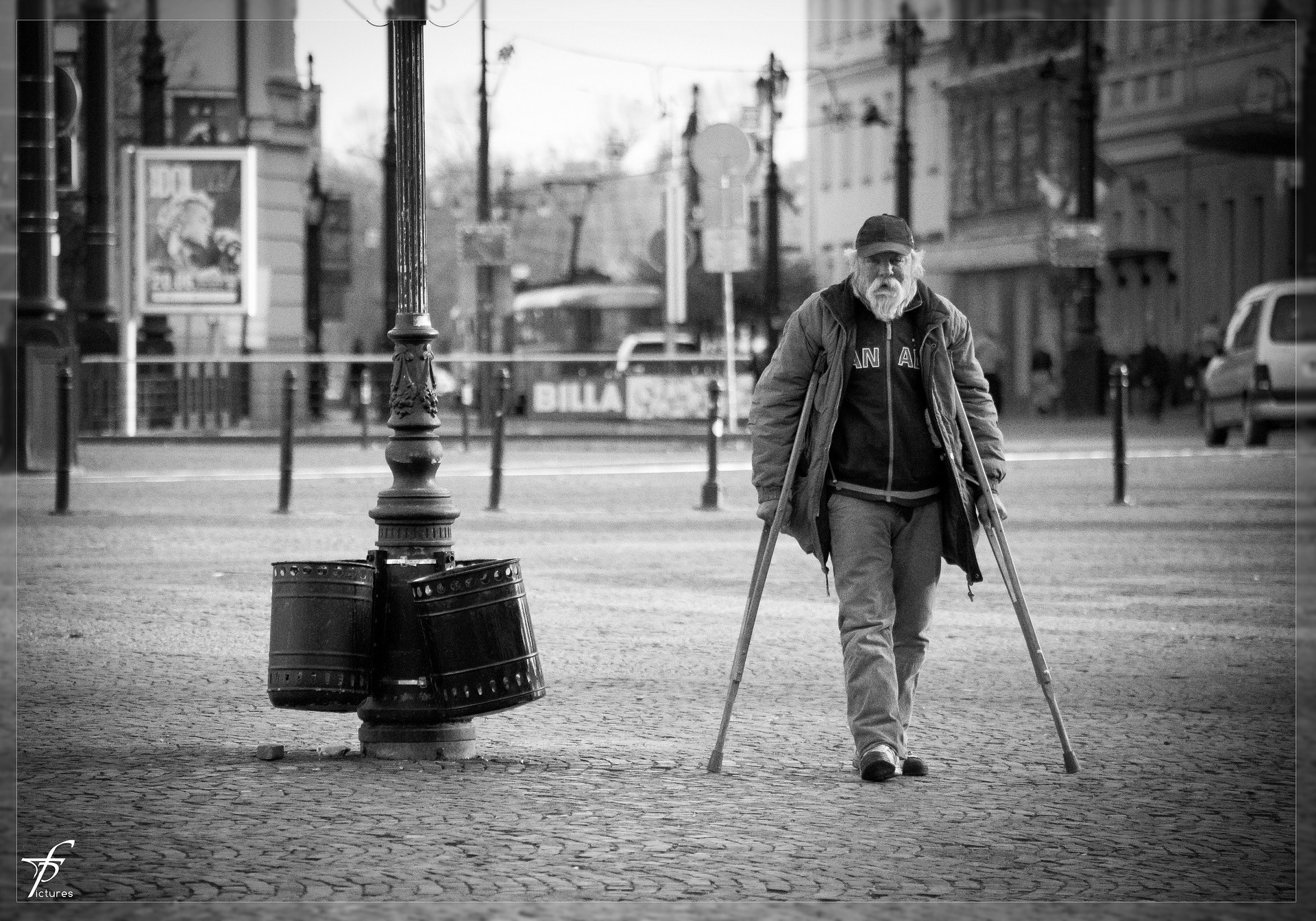 Old man walking on crutches
