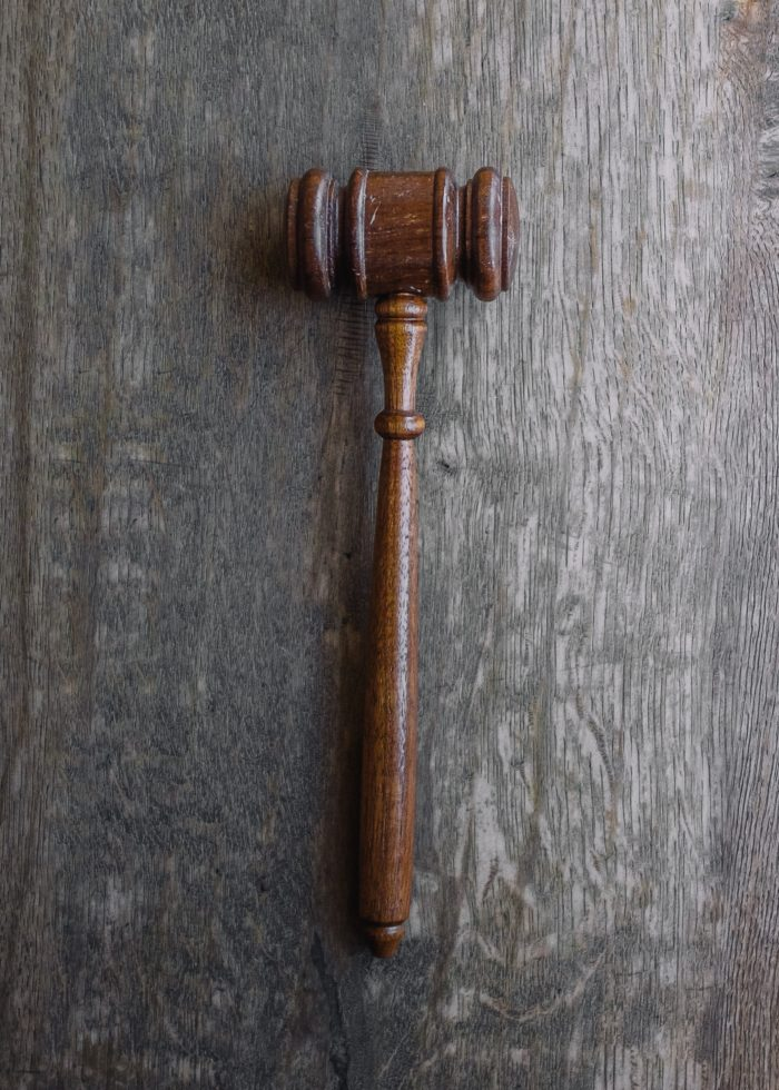 A gavel lies on a table.