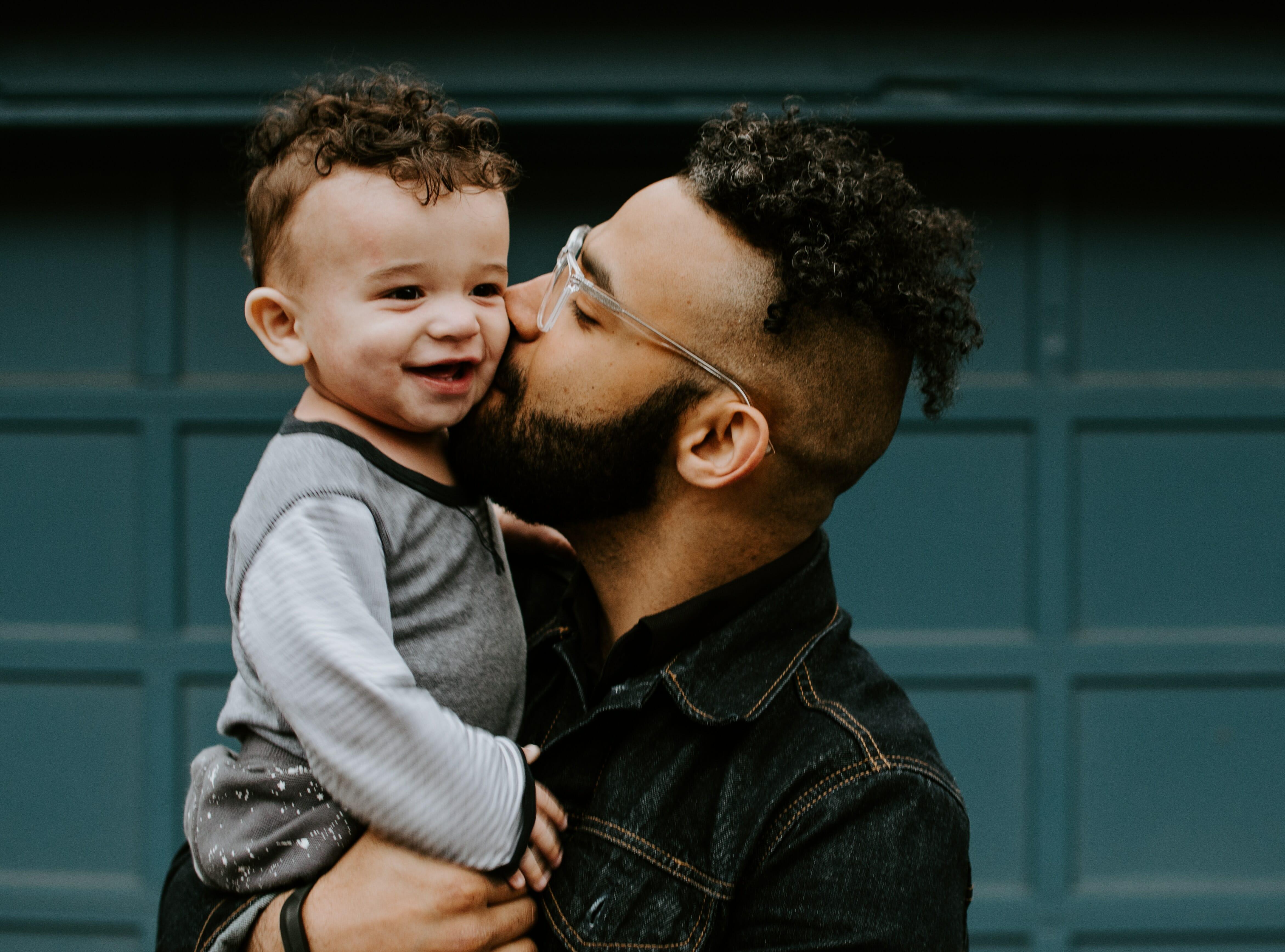 Man hugs his son