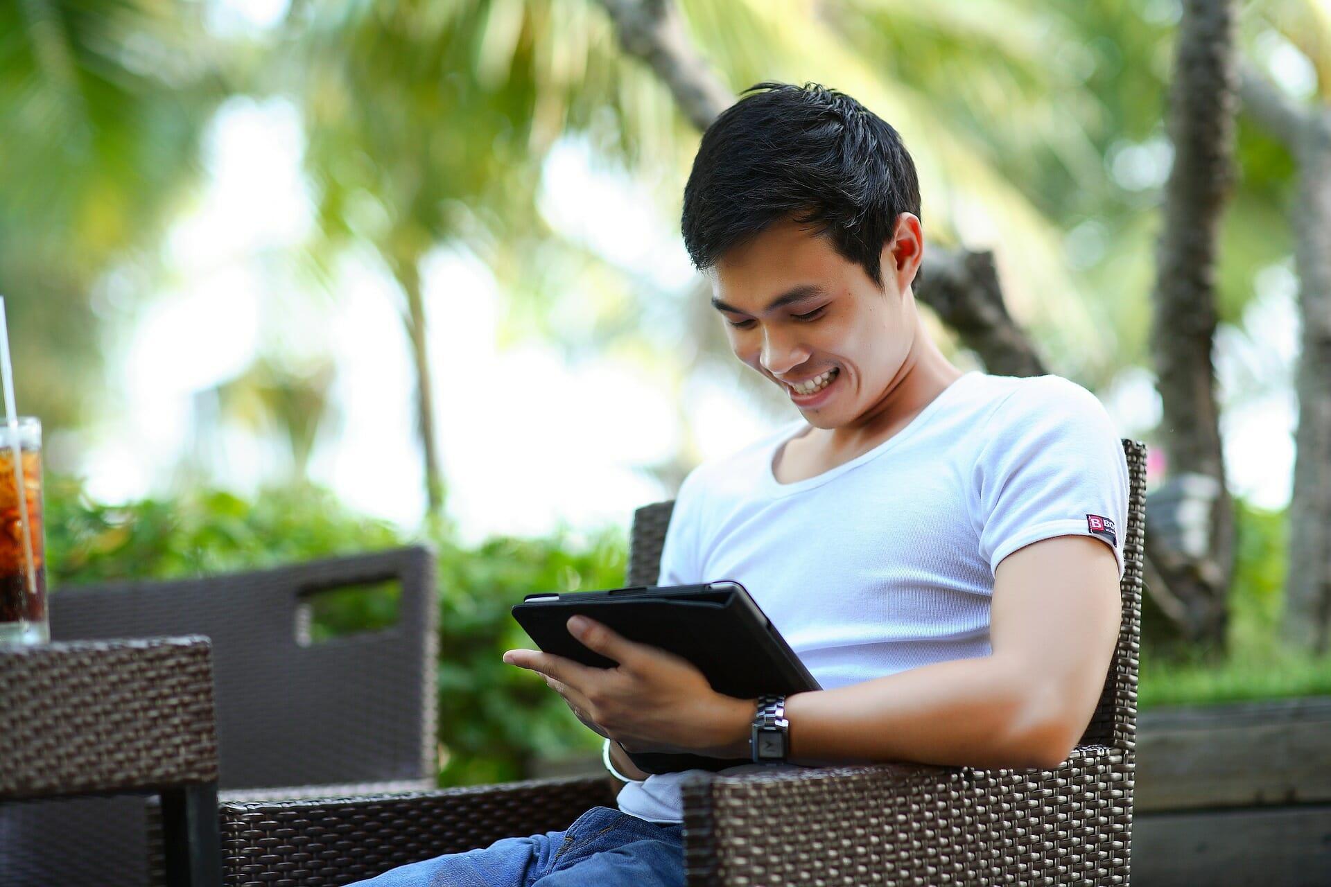 Man looking at his iPad