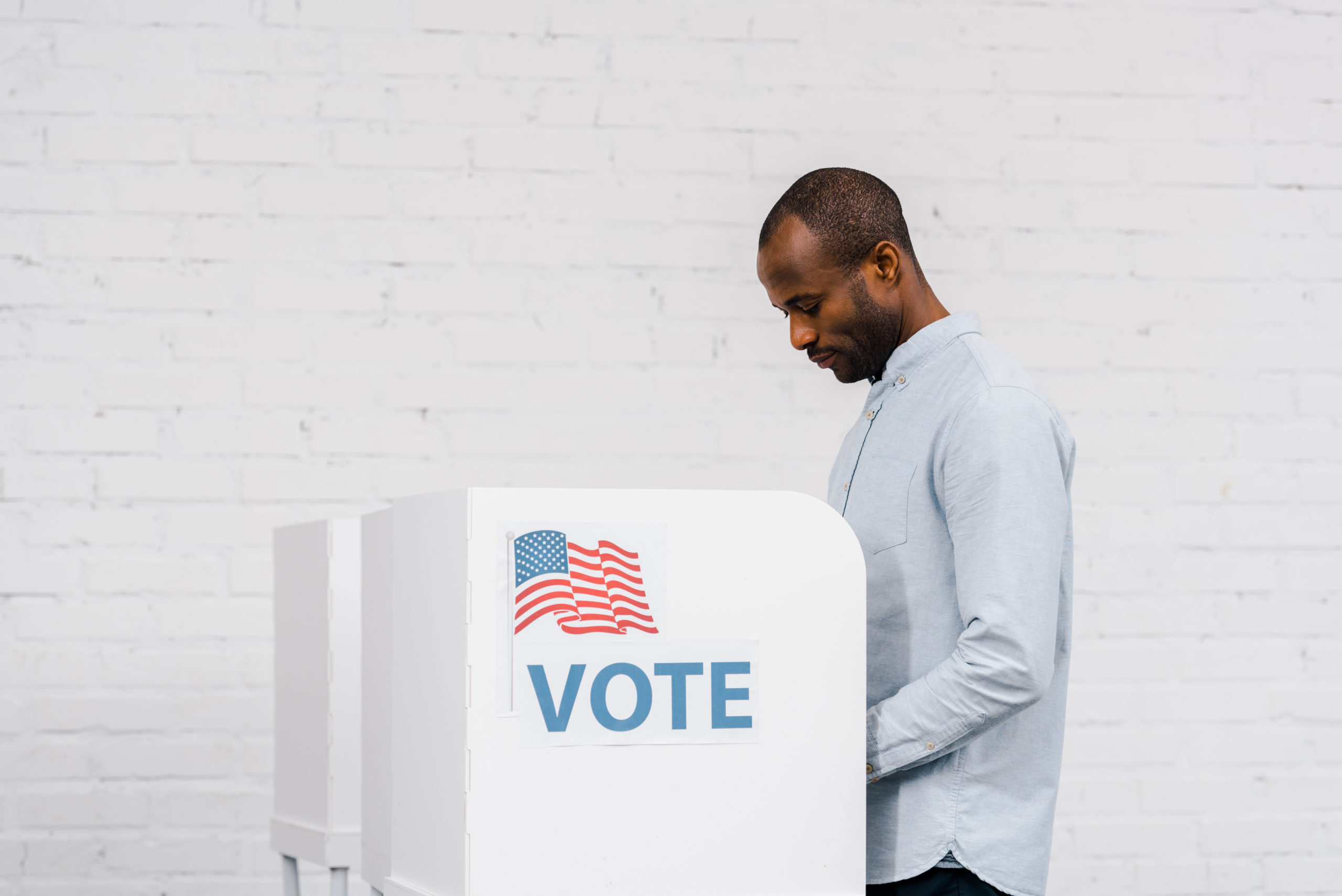 An immigrant casts his vote in the the U.S. presidential election.
