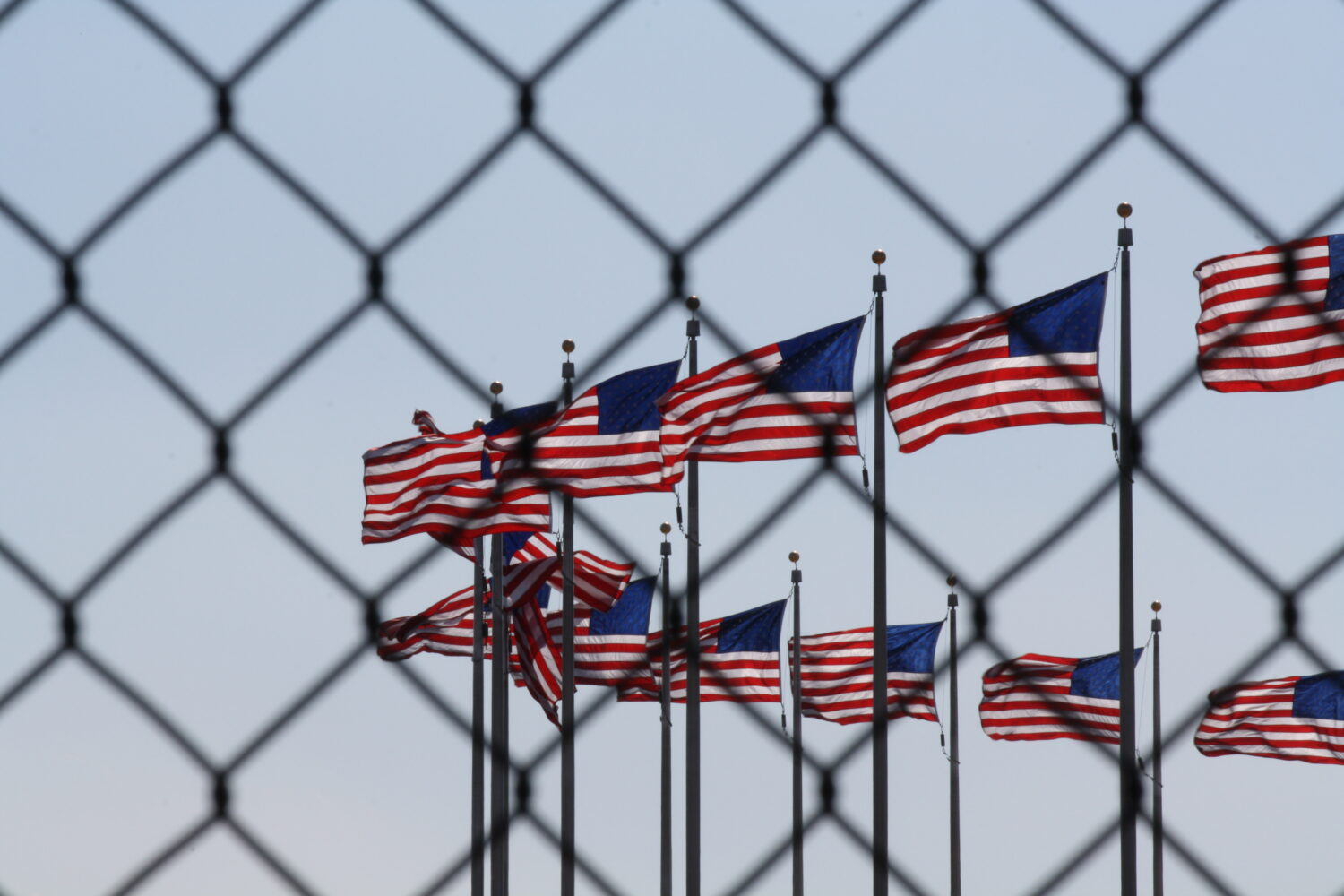 American flags behind a fence