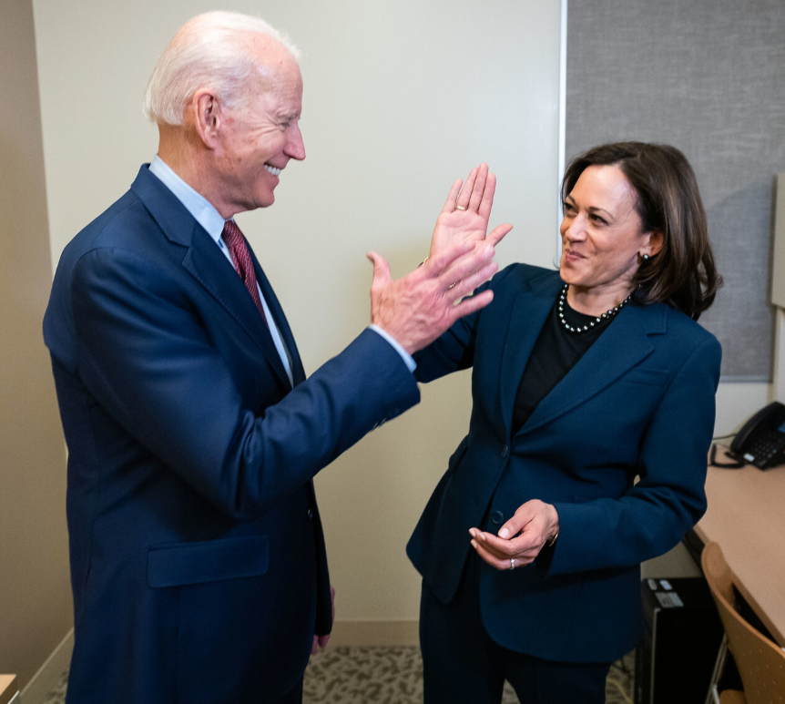 Biden and Harris high five each other