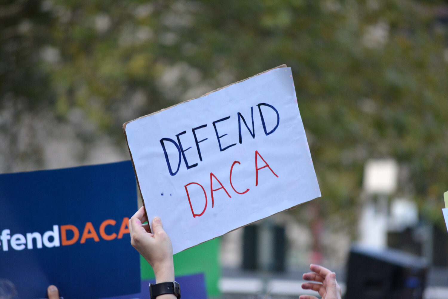 Defend DACA sign at a protest