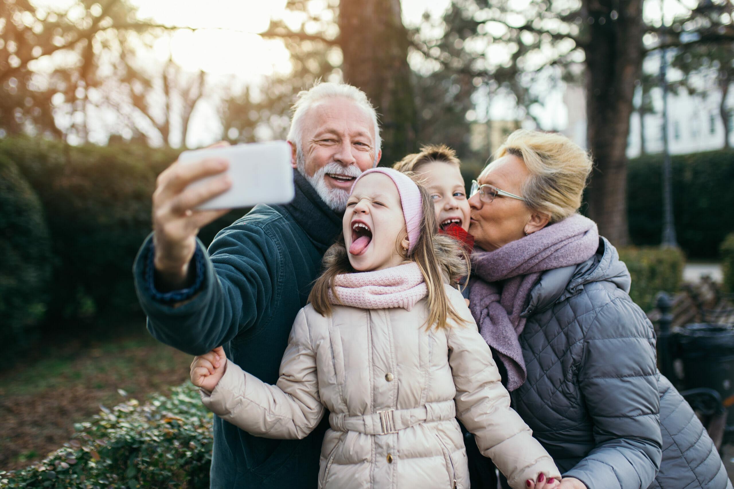 Grandparents taking a selfie with grandkids