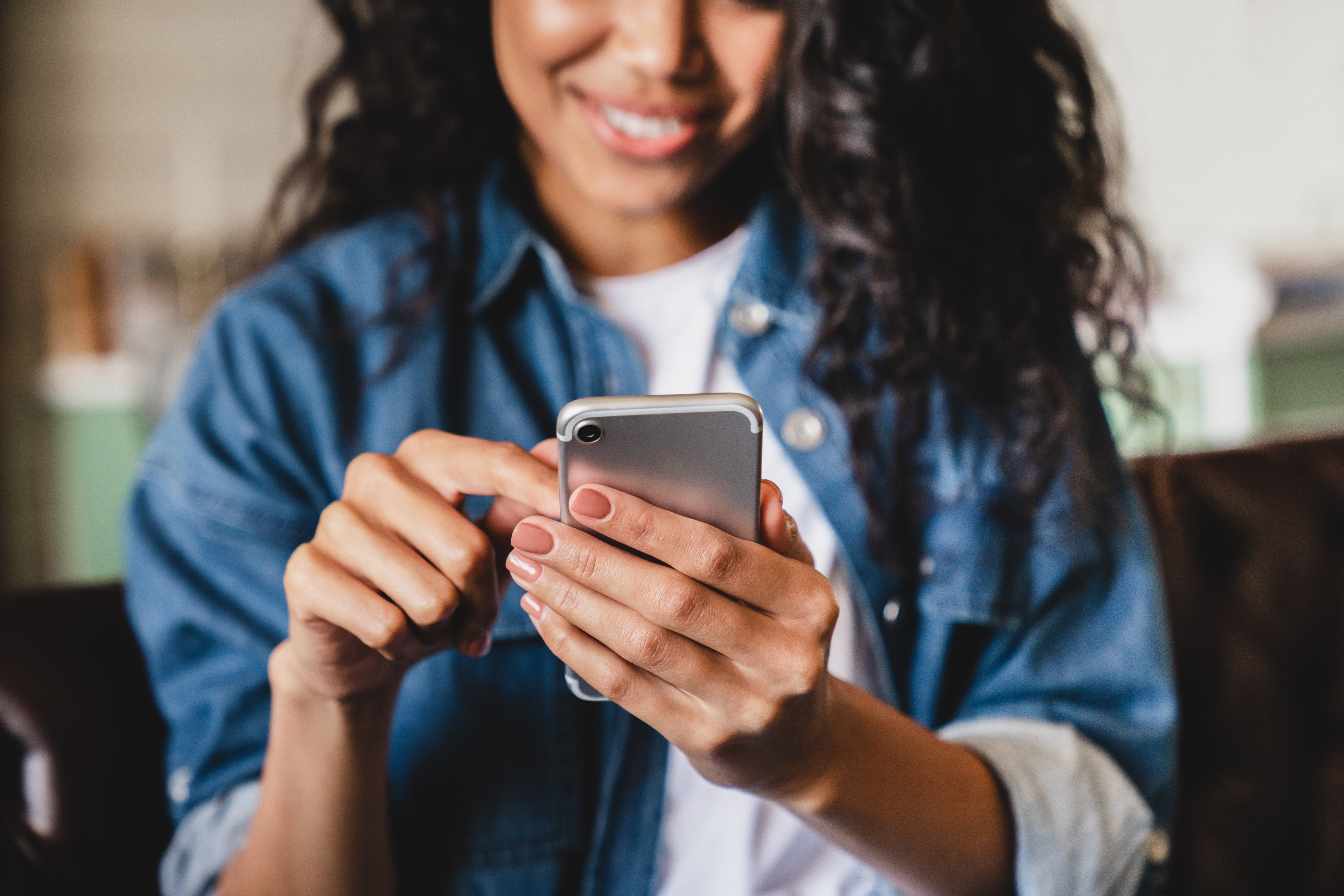 An immigrant looks at a language app on her phone.